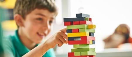 Boy playing with colourful building blocks