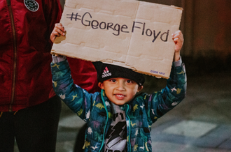 Boy protesting for George Floyd
