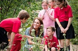 HRH Duchess Of Cambridge with children in the Back To Nature Garden