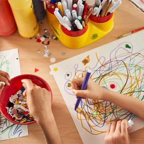 Children's hands, drawing and doing crafts