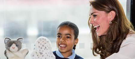Child with Duchess of Cambridge using puppets