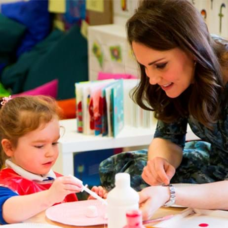 The Duchess of Cambridge helping a child do crafts