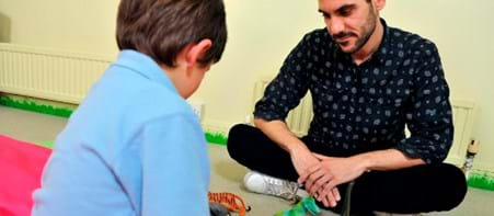 Child playing with toys in counselling session