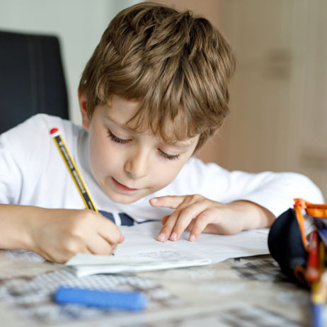 boy writing on paper