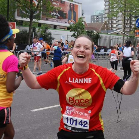 Place2Be runner making fists in celebration and smiling