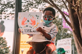 child taking part in protest