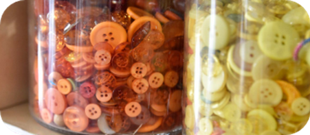 Jars of colourful buttons