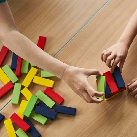 Children's hands with colourful building blocks