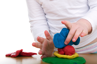 child with playdough