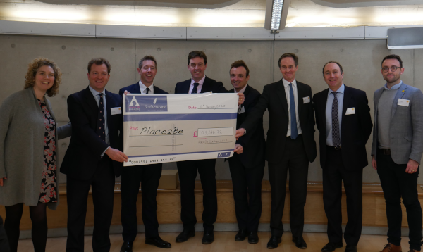 Some of the heads visited a Place2Be school to present us with their donation (giant cheque).