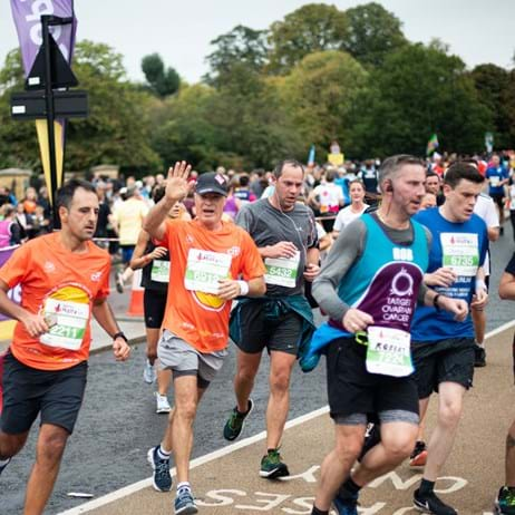 Place2Be and other runners, one waving